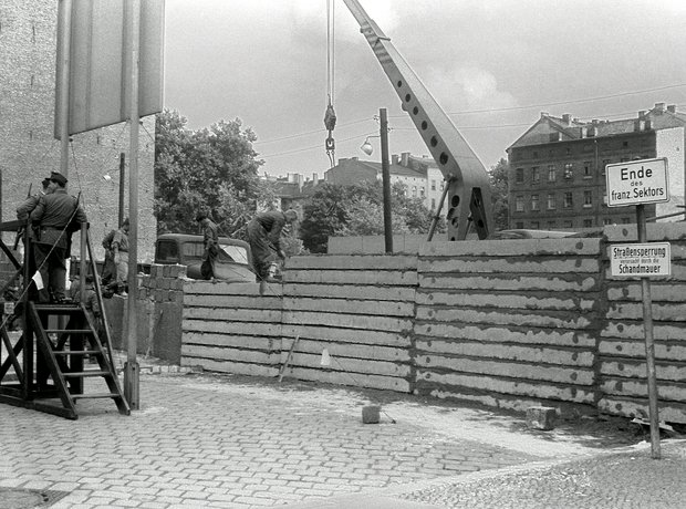 The Berlin Wall being built in 1961