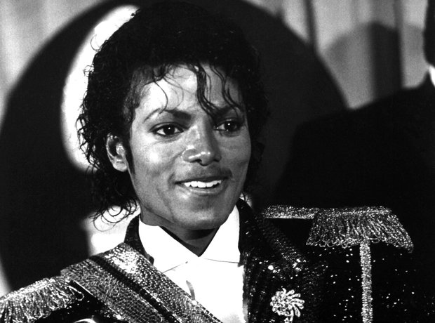 Michael Jackson with Grammys for Thriller 1984